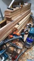 photo of a big pile of wood in the shed